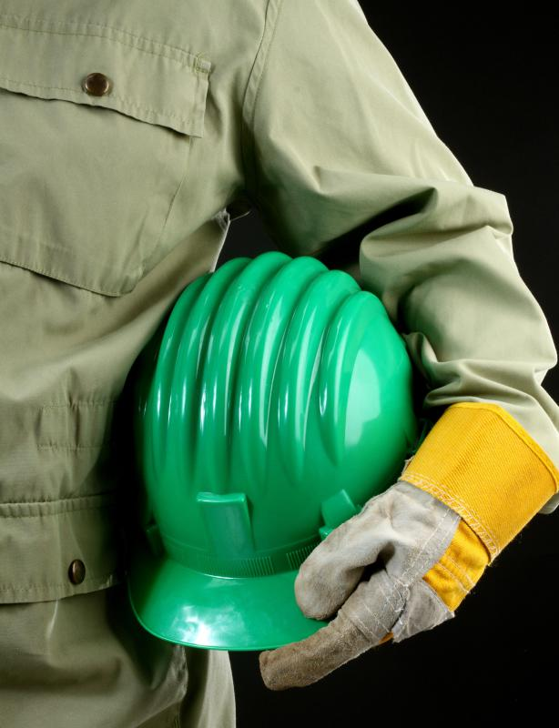 Constructors are required to wear safety gear, including hard hats and gloves.