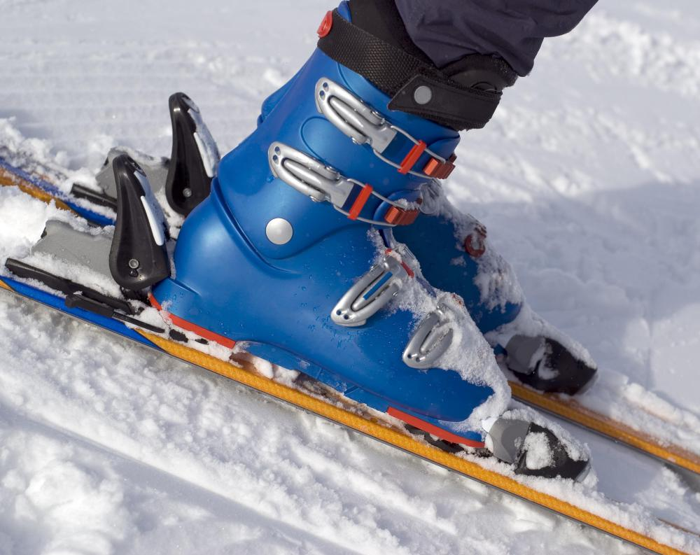 Alpine skiing requires special boots that fasten onto the skis via bindings.