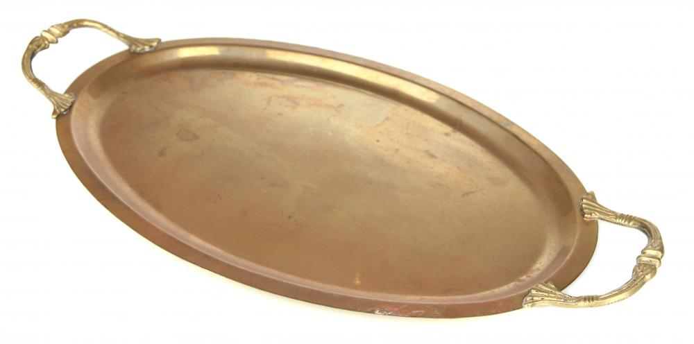An antique brass serving tray.
