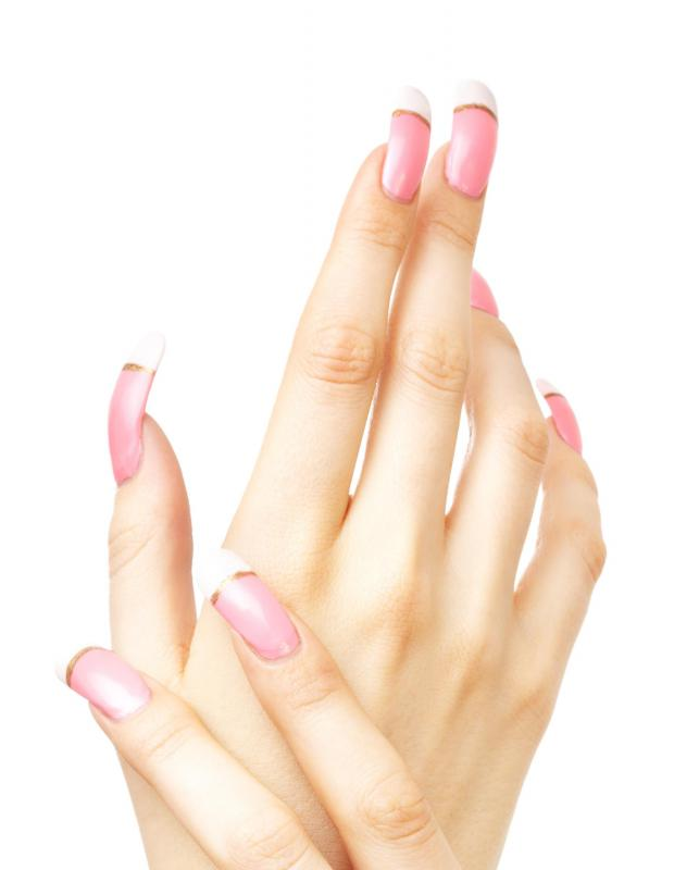 Artificial fingernails can leave white spots on fingernails when they're removed.