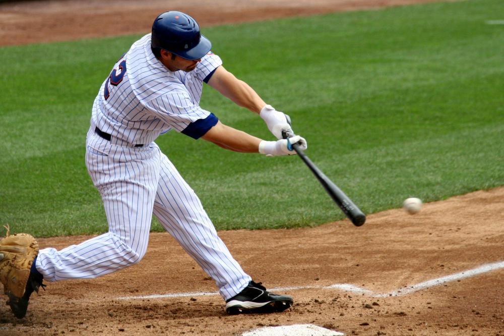 A baseball player can advance to base after hitting a ball that falls within playable limits and that has not been caught or fielded to the base he is advancing toward.