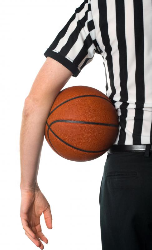 Referees oversee basketball games to make sure rules are followed and penalties assessed when needed.