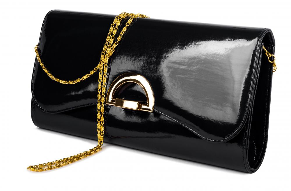 If you don't carry many items in your handbag, a small custom-made bespoke clutch might be a great purse party pickup.