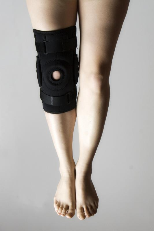 A person wearing a meniscus brace.