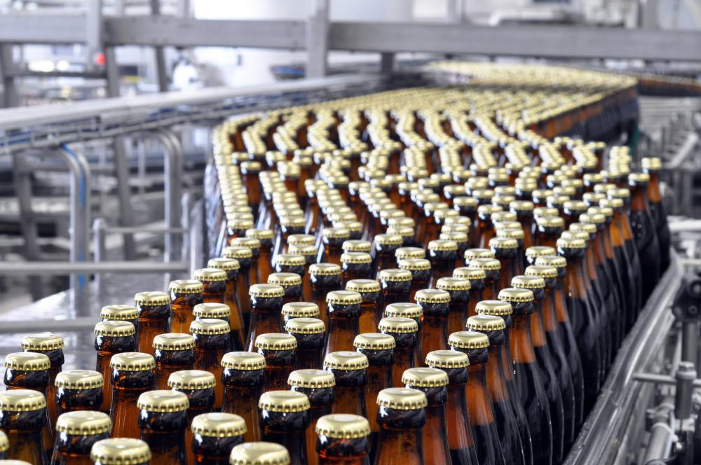 Conveyor systems are used to move a large quantity of goods across an area, like the conveyor belts in a bottling plant.