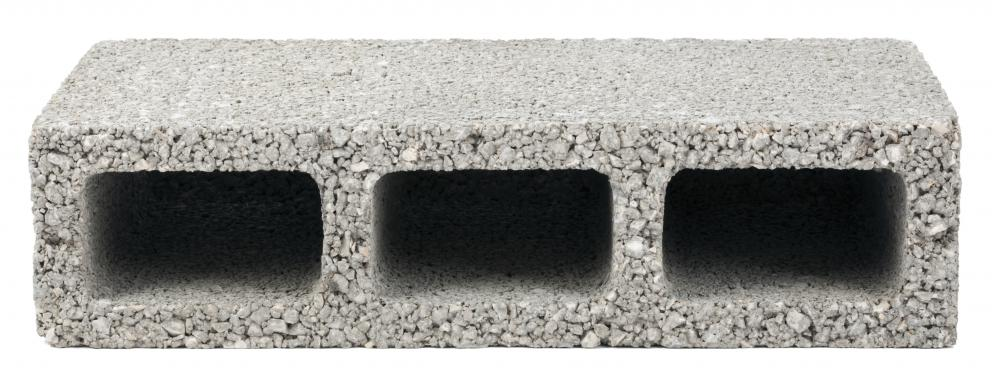A breeze block, often used to lay a foundation, is typically made of a blend of concrete and ash.
