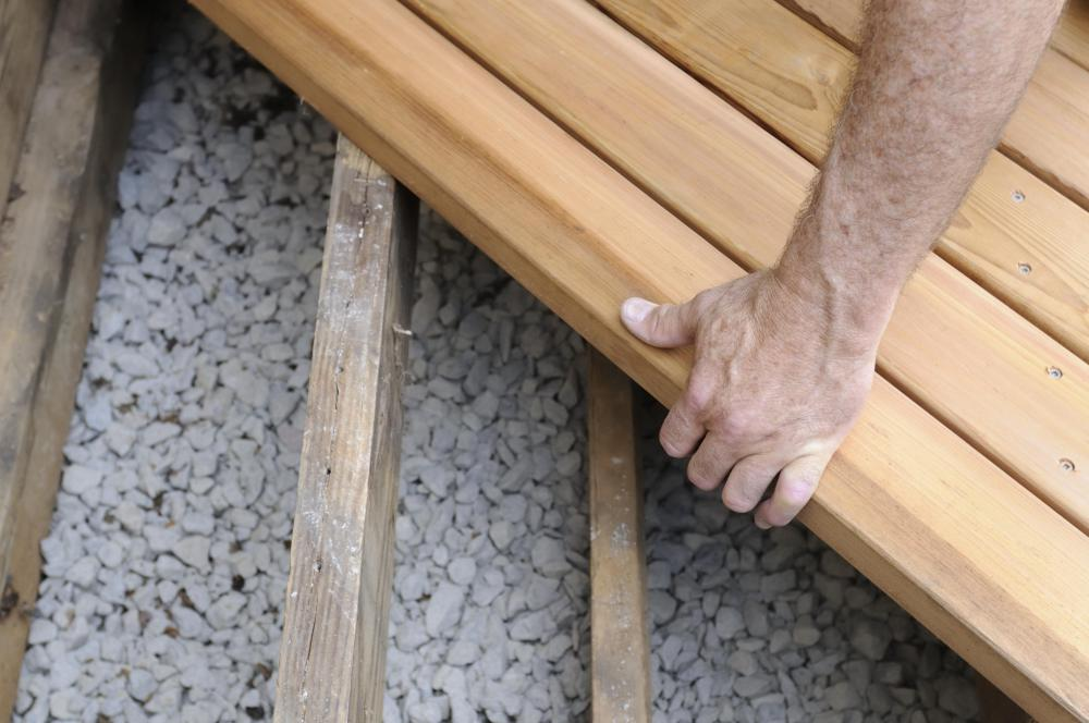 Ground level timber decks can make a good do-it-yourself home improvement project.