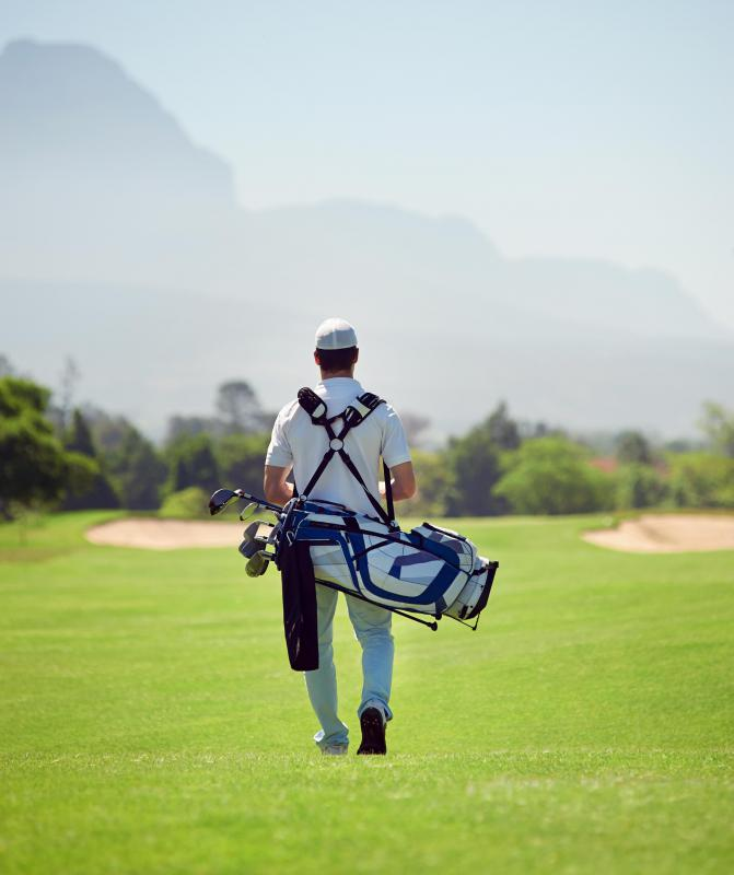 Caddies are responsible for transporting a golfer's bag and clubs around the course.