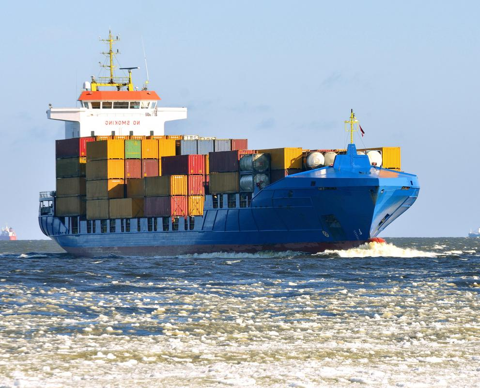 Cargo ships carry many shipping containers.