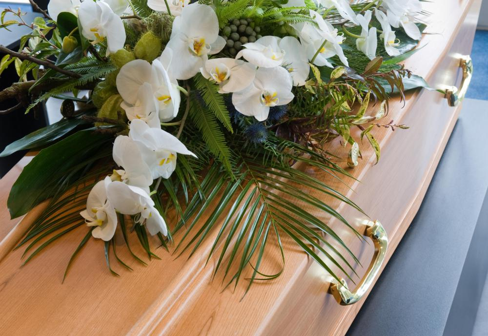 Flower arrangements may be created for a memorial.