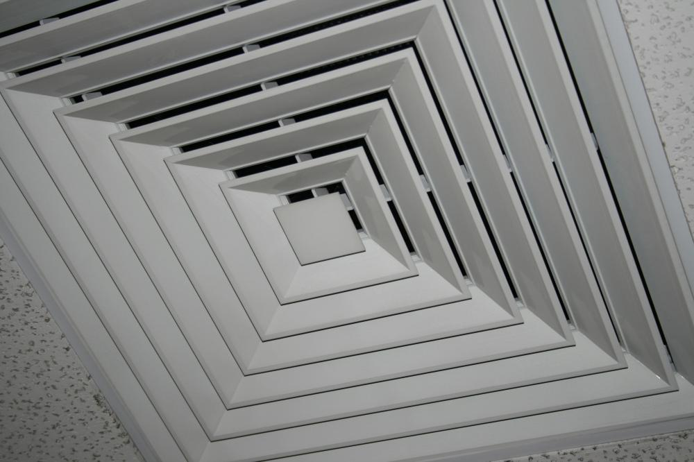 An air conditioning vent in a ceiling.