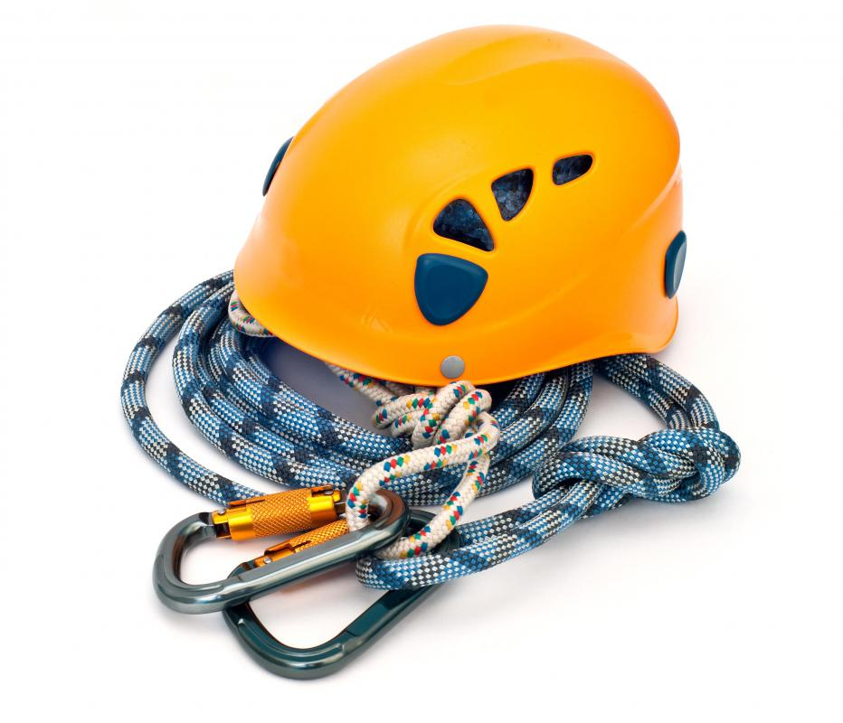 Climbing equipment, including a helmet, rope, and carabiners.