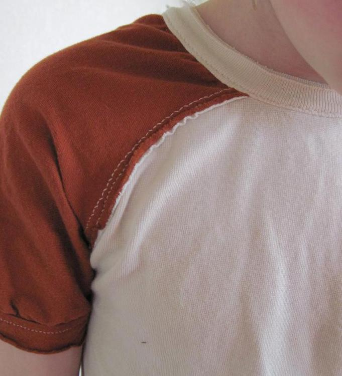A raglan sleeve has a seam that moves from the underarm to the neckline.