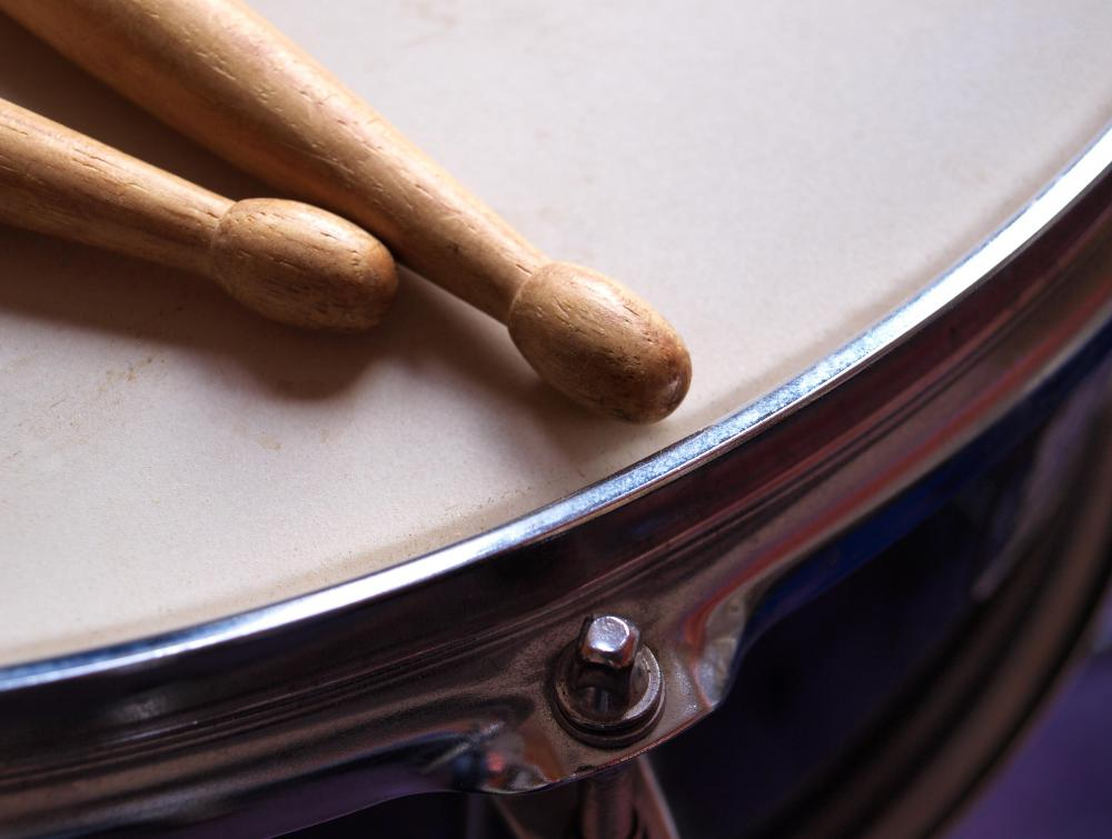 Percussion is most commonly associated with drums, but can include other instruments such as the triangle.