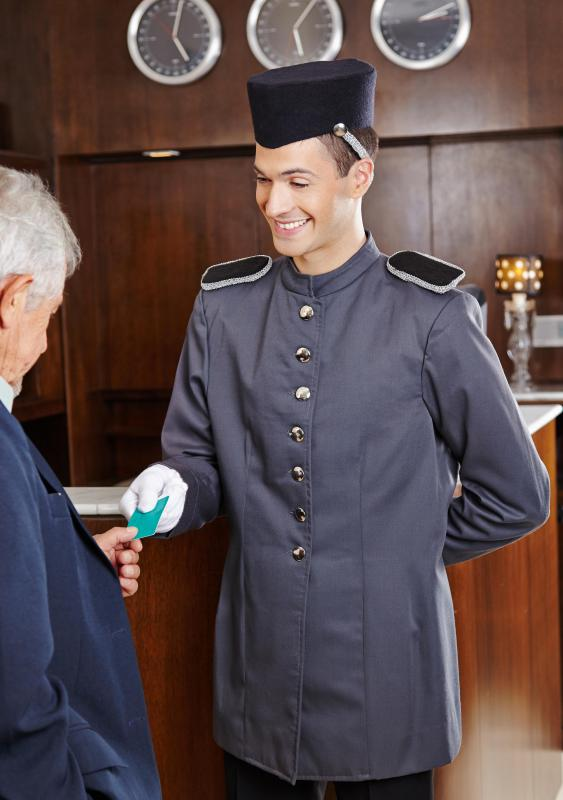 A bellhop might count on tips to augment relatively low wages.