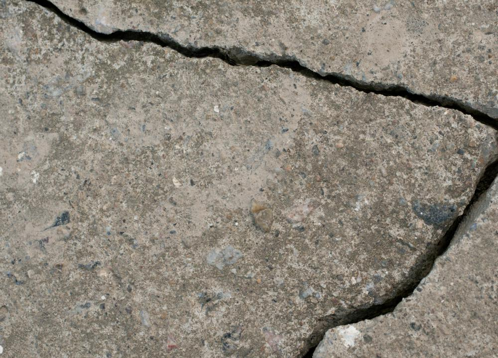 Paint can be used to cover up cracks on cement floors.