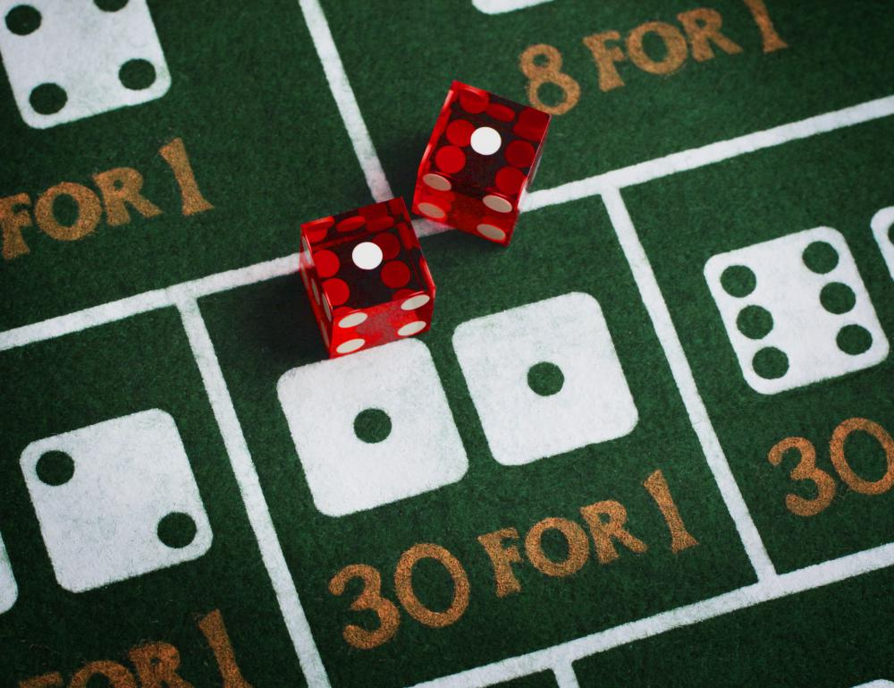 Gambling addicts place compulsive bets on casino games, such as craps.