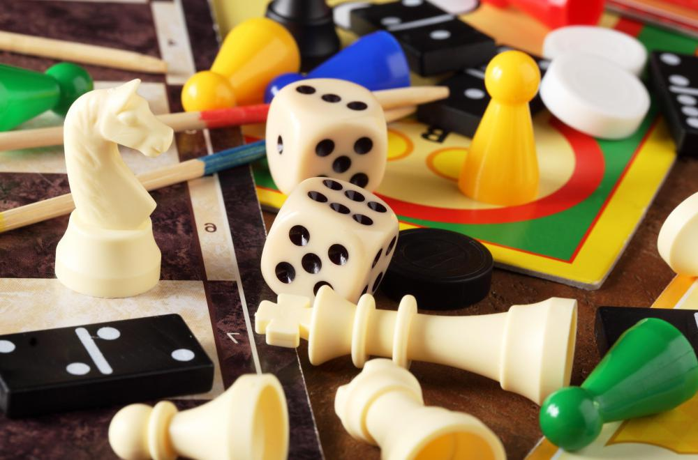 Board games often have tokens, pawns, dice, cards, or other playing pieces that are used in specific ways throughout the game.