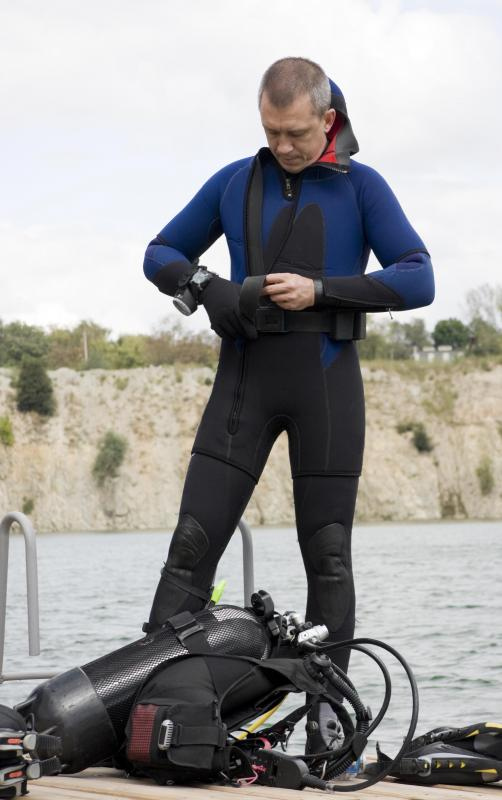 Equipment that can aid in navigation, such as prismatic compasses, can be worn over wetsuits.