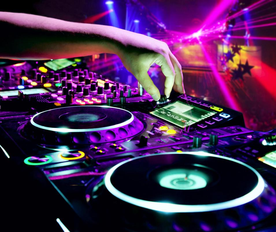 Many DJs earn their living by playing musical recordings at bars and clubs.