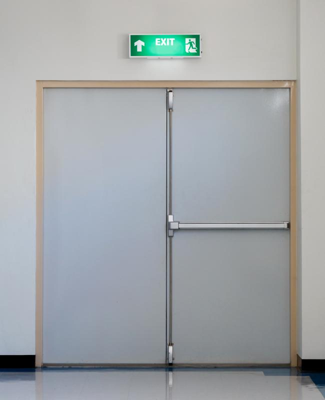 "Egress doors are typically indicated with a back lit sign marked ""Exit""."