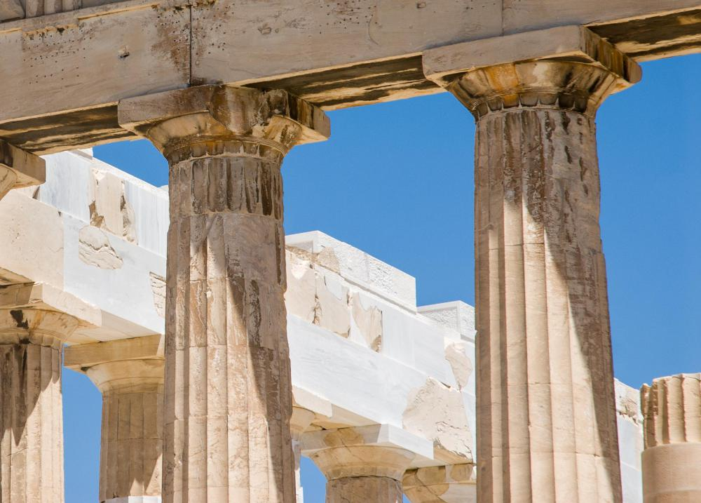 A Doric capital is a simple rectangular structure set on top of a round column.