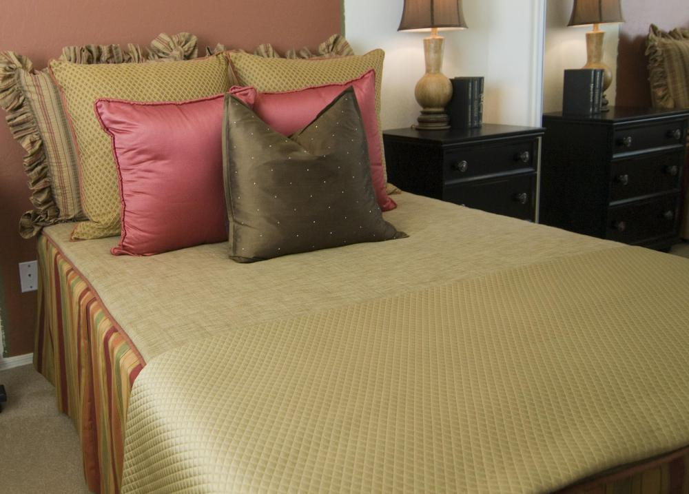 A double bed takes sheets that are 54 inches wide by 75 inches long.