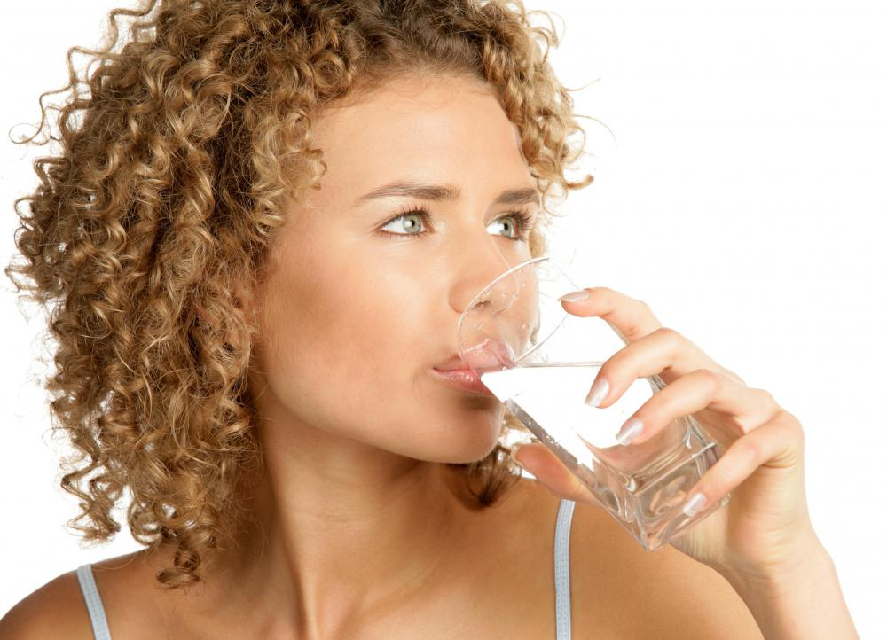 Drinking water to improve urinary flow.