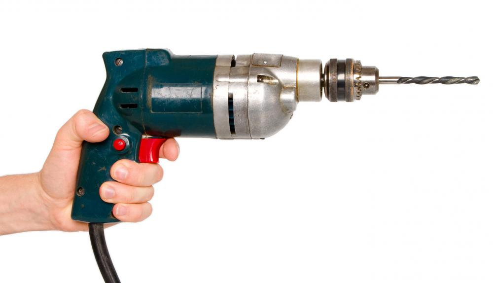 Electric drills may be used to push screws into wood surfaces.