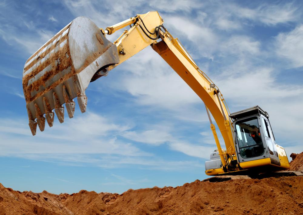 An excavator's boom is the long, arm-like part that is used to lift and move a bucket that carries earth.
