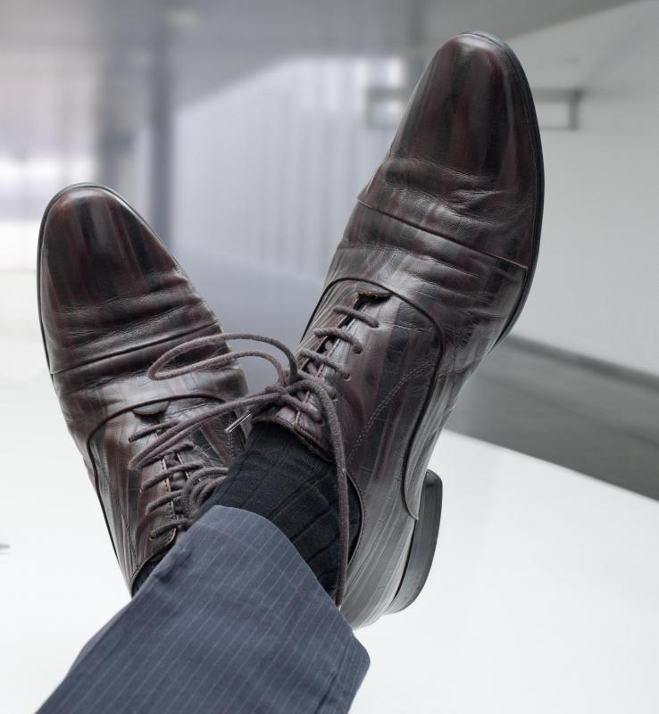 Modern power suits are typically paired with black leather shoes and black socks.