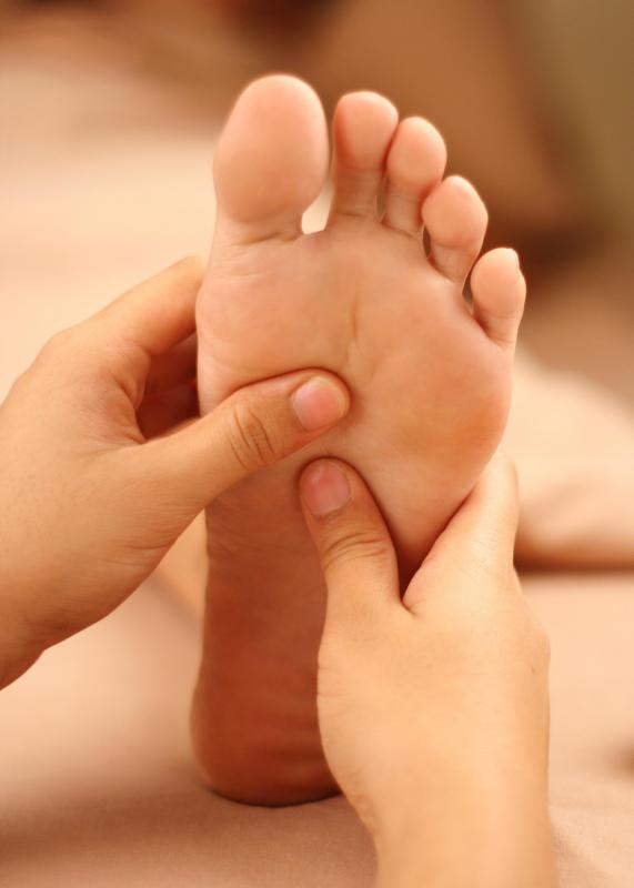 A foot massage may help treat toe spasms.