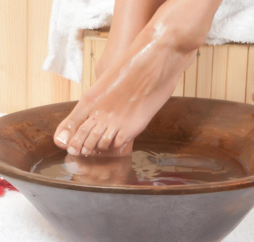 Soaking the affected foot in warm water is one home remedy for toenail treatments.