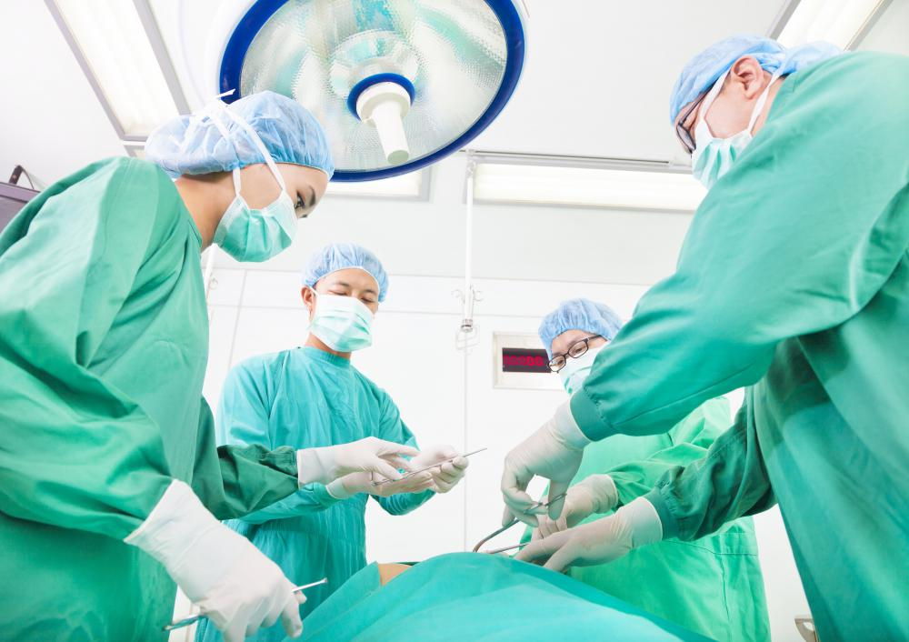 In complicated situations, surgery may be necessary to remove all or part of the tumor.