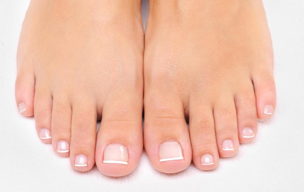 A clear base coat is typically used on the nails during a pedicure.