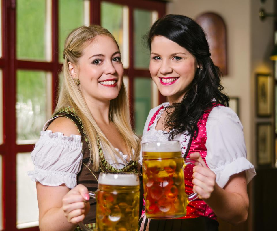 Many people dress in traditional Bavarian costumes when attending Oktoberfest.
