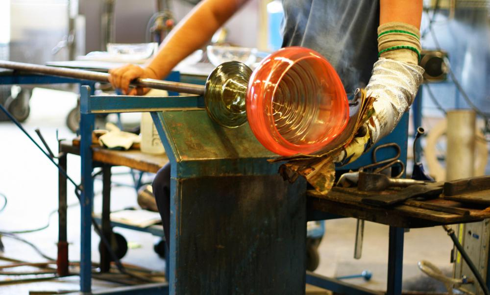 Glass blowers use blowpipes to inflate and shape molten glass into items such as vases, bottles or cups.