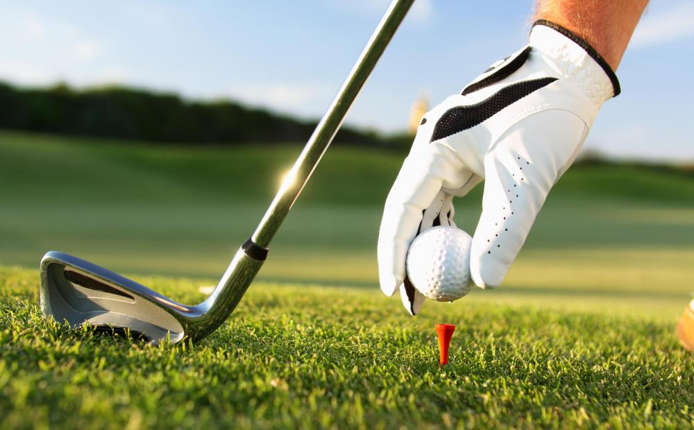 At the beginning of each hole, a golfer hits his ball from a tee that raises it above the ground.