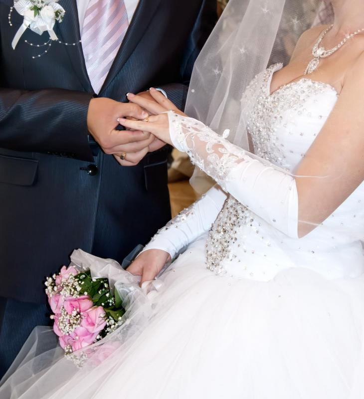 The bride traditionally tosses her bouquet after she gets married for one of the women at her reception to catch.