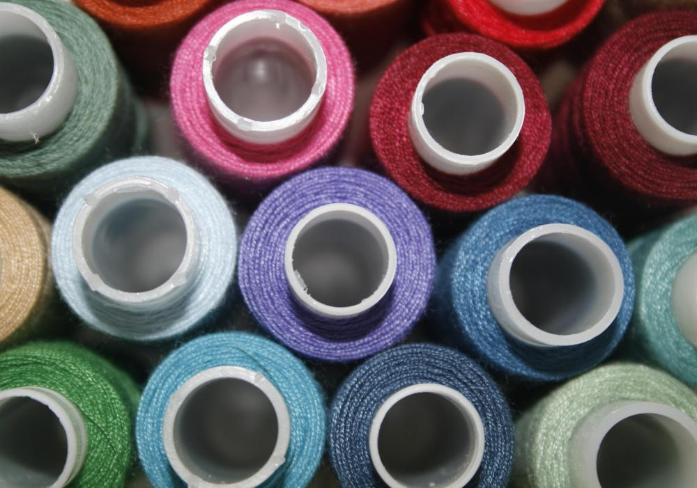 Raw materials may be turned into thread for use in making textiles.
