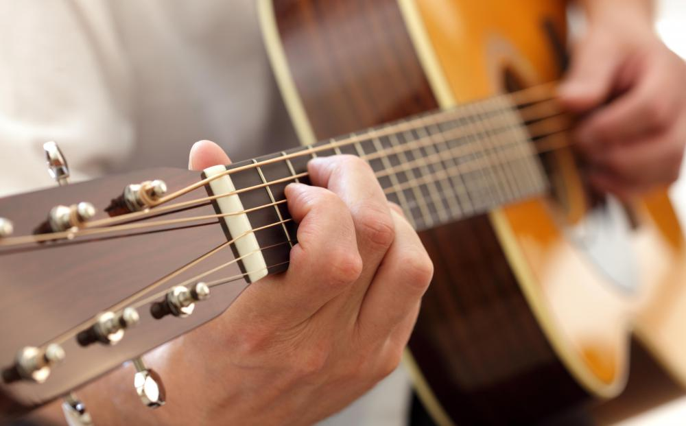Humidity and string tension can cause a guitar's neck to bow.