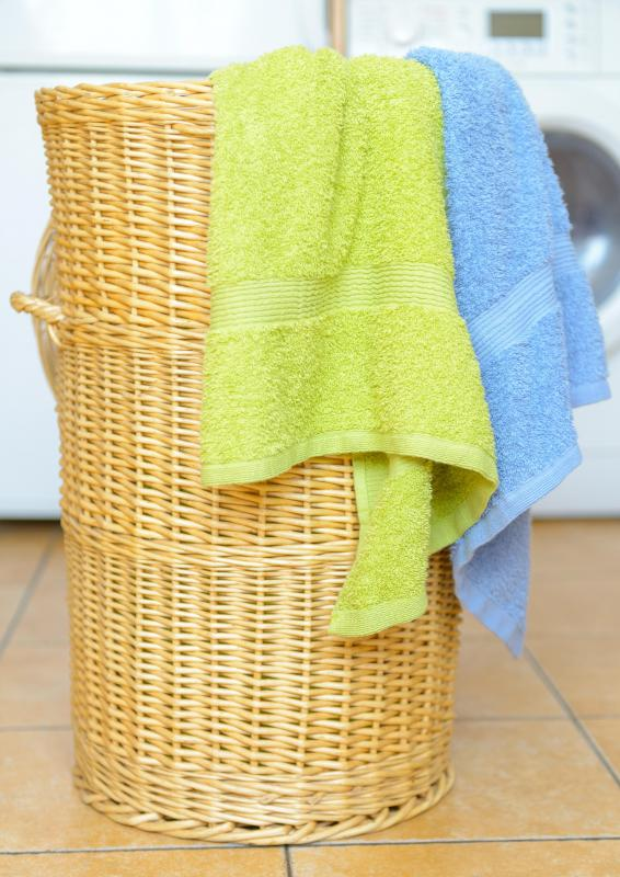 Hampers may be used instead of laundry bags to collect dirty clothes.