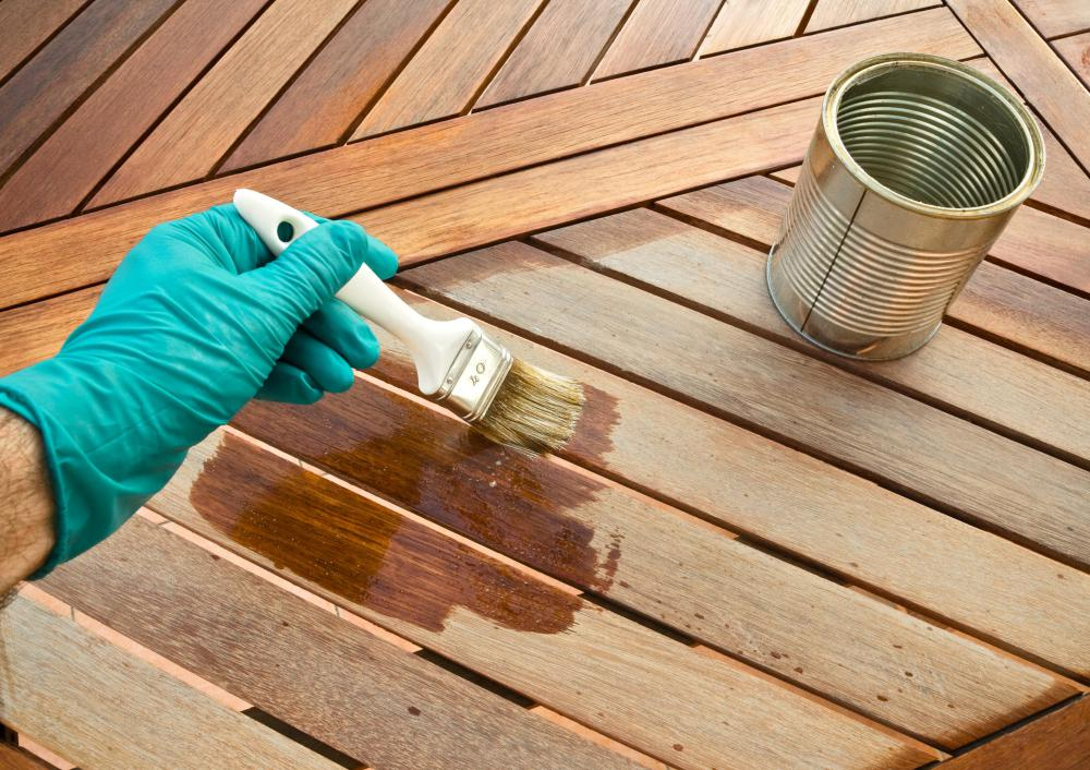 Applying a varnish can give a wood table a rustic appearance.