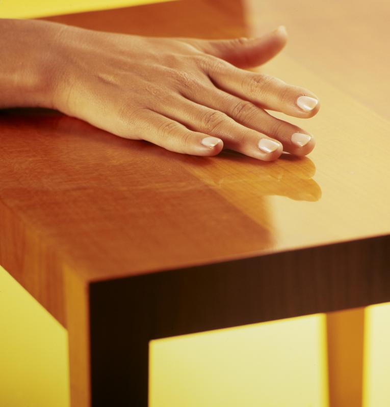 Polymer resins may provide glossy coatings for furniture.