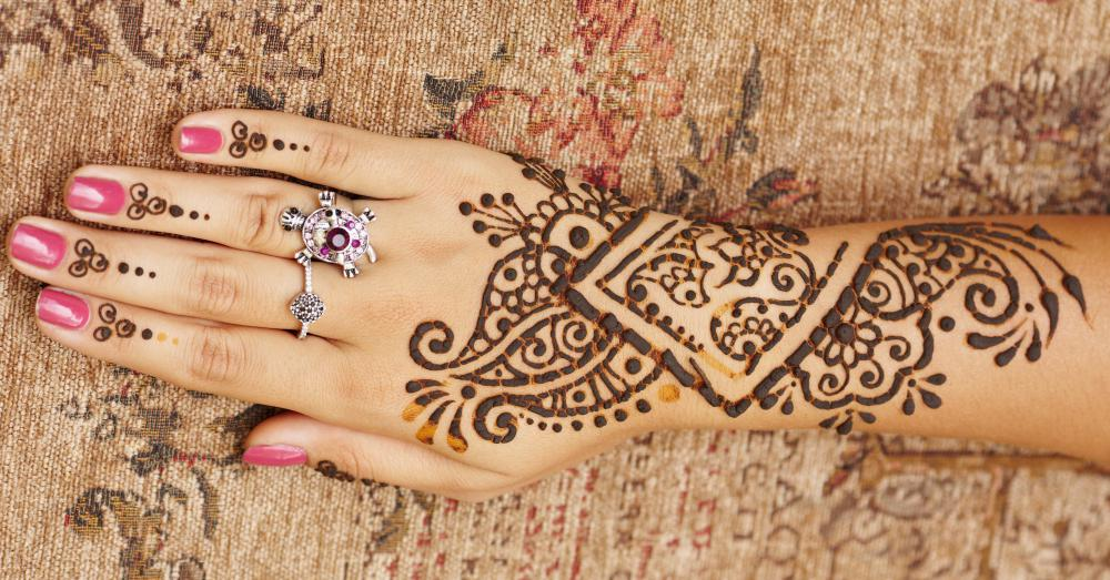 A henna tattoo on the arm and hand.