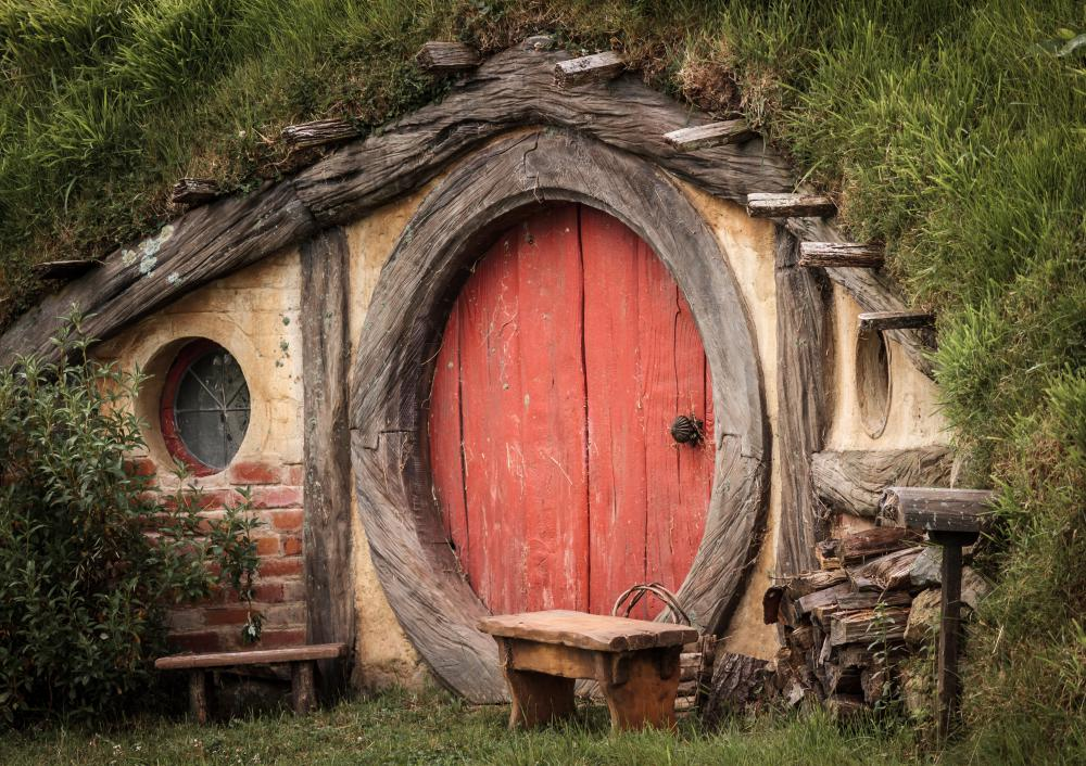 The Hobbit Hole from the 'Lord of the Rings' movie set was first described by J. R. R. Tolkien in his novels, long before the movie was produced from an adapted screenplay.