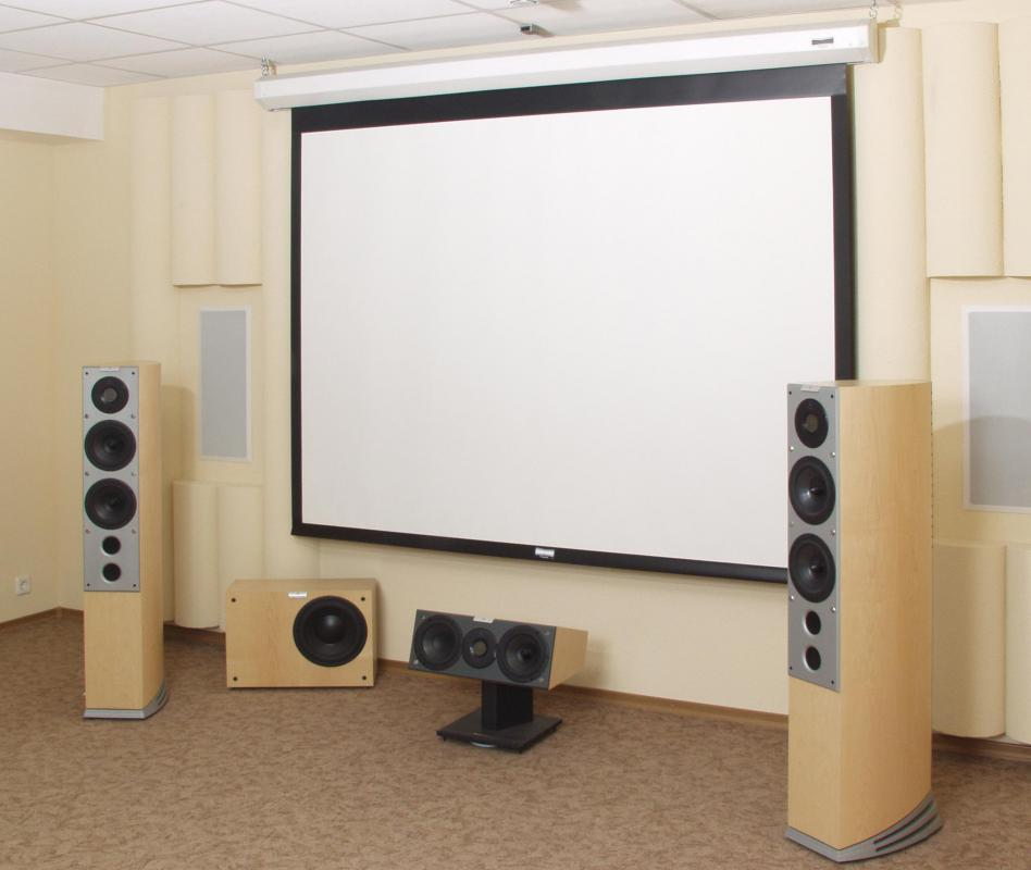 A home theater may have a large projection screen rather than a television to make it feel more like a movie theater.