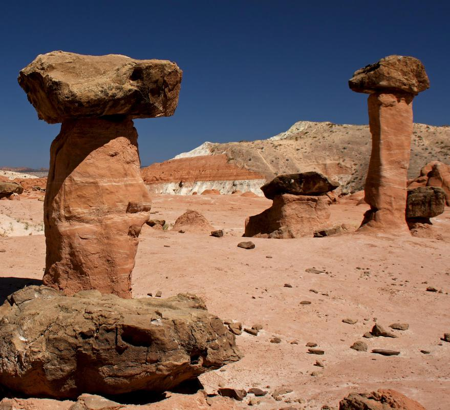 """Hoodoo"" is also a name for a tall, somewhat cylindrical desert rock formation."