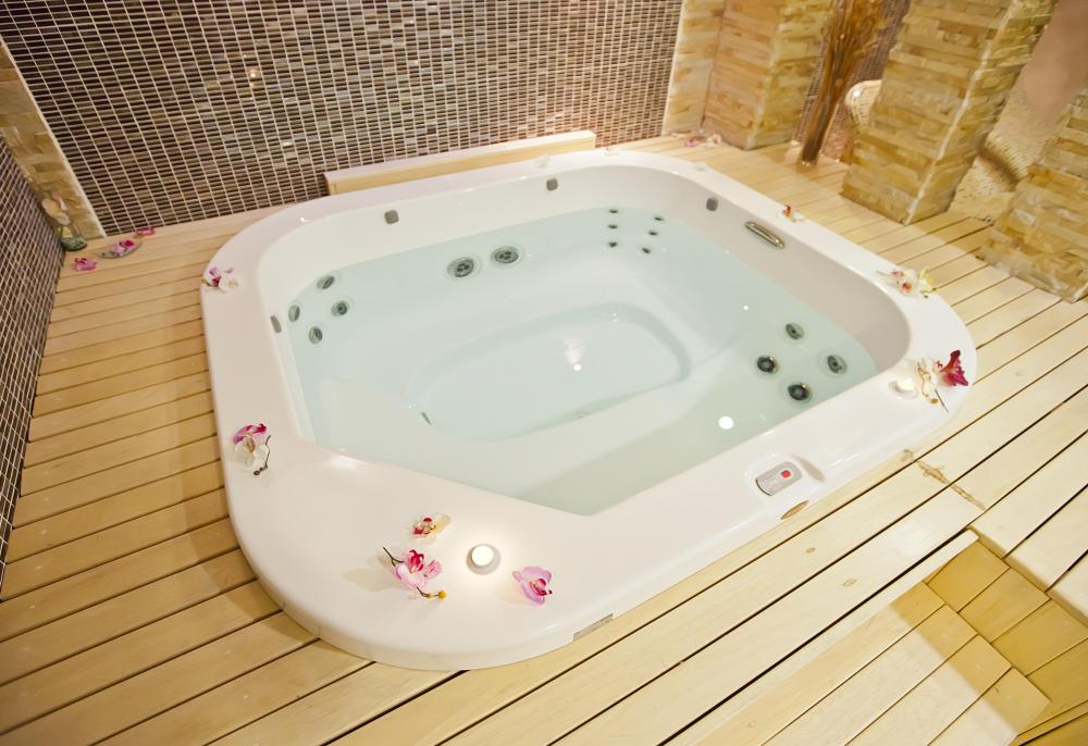 A water-filled hot tub, also known as a Jacuzzi®.