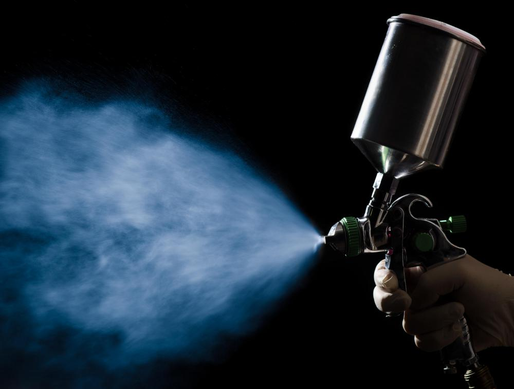 A spray gun should be used on fiberglass to provide a smoother coat.